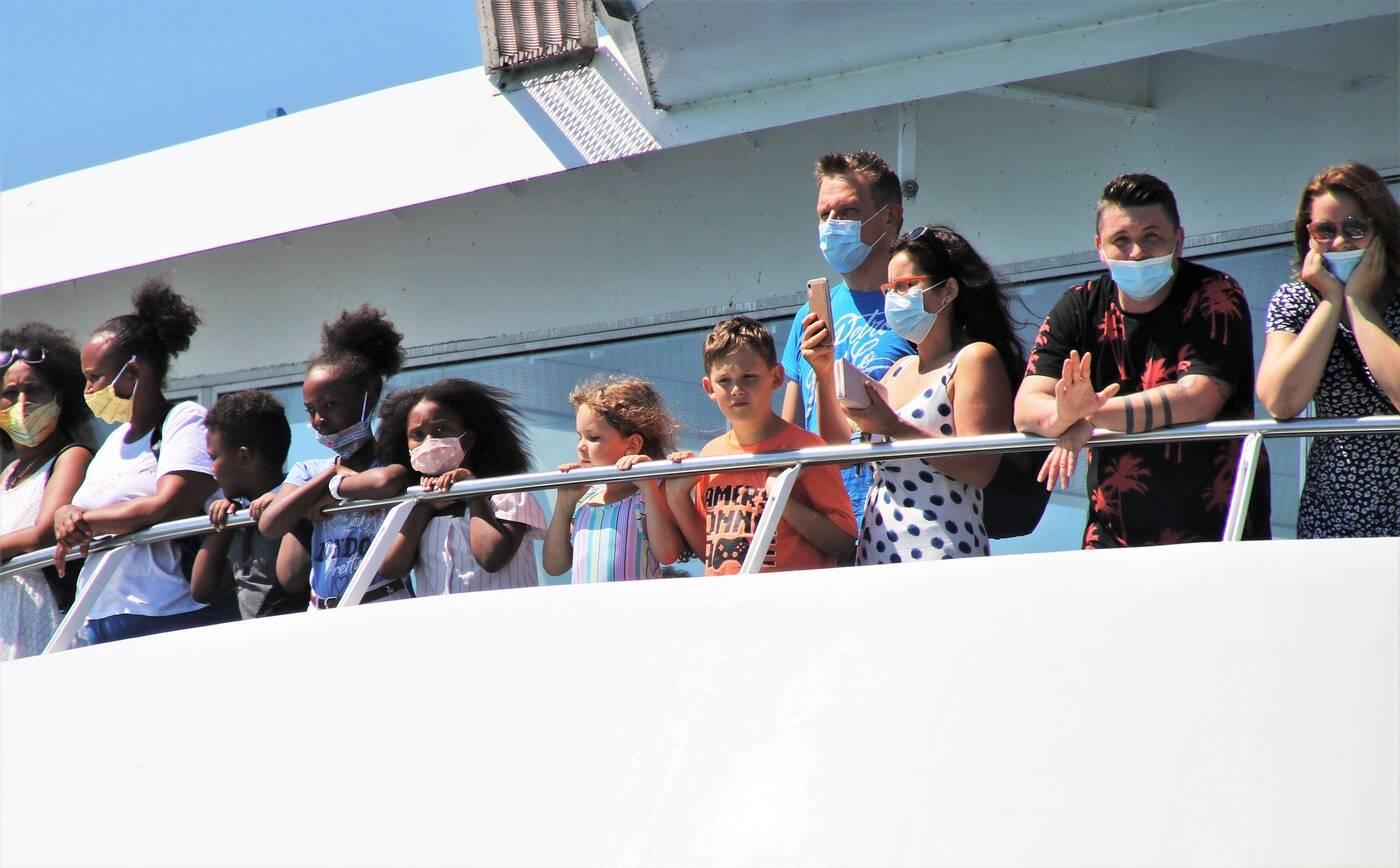 Ferry passengers wearing masks