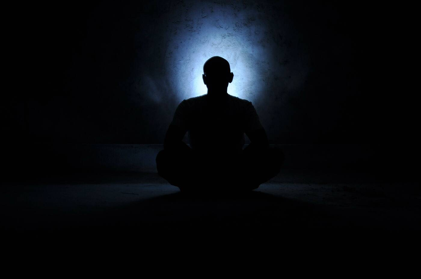 Home.fit man-meditating-cave-darkness A Tale of Love and Service